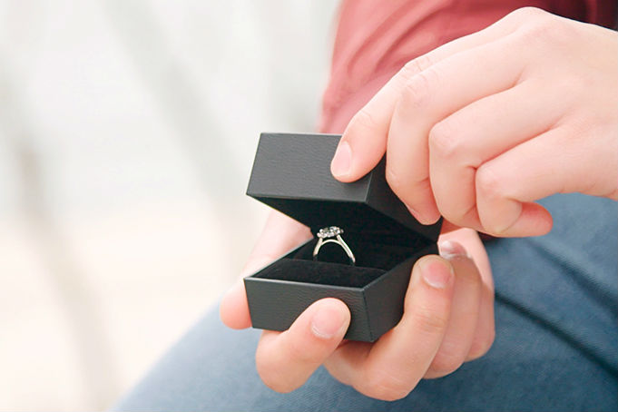 mother in law's guide to buying engagement rings man opening ring box