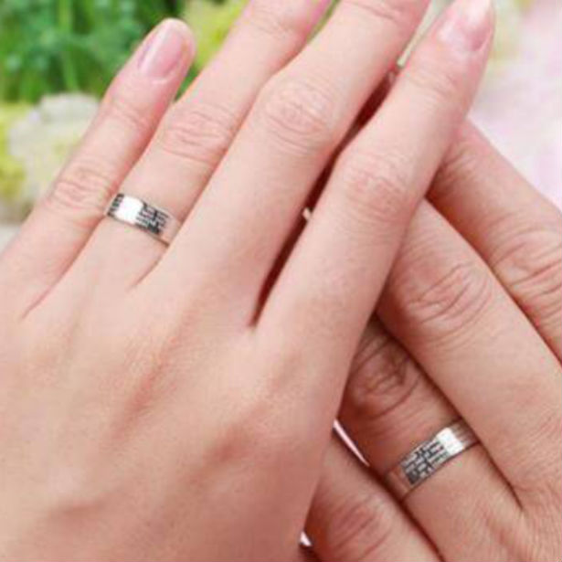 couples hands wearing platinum ring bands