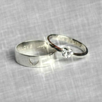engagement ring and wedding band on grey background