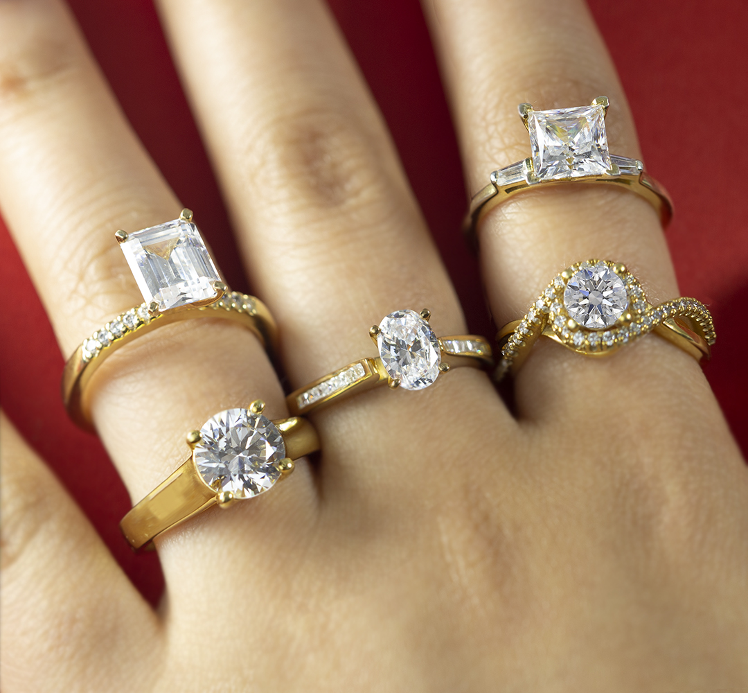 Yellow-gold diamond engagement rings in various shapes