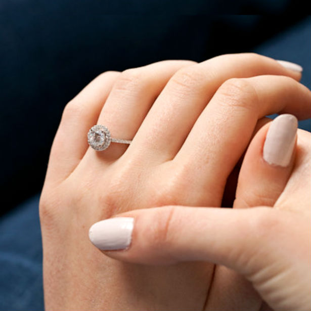 woman wearing engagement ring with accent diamonds