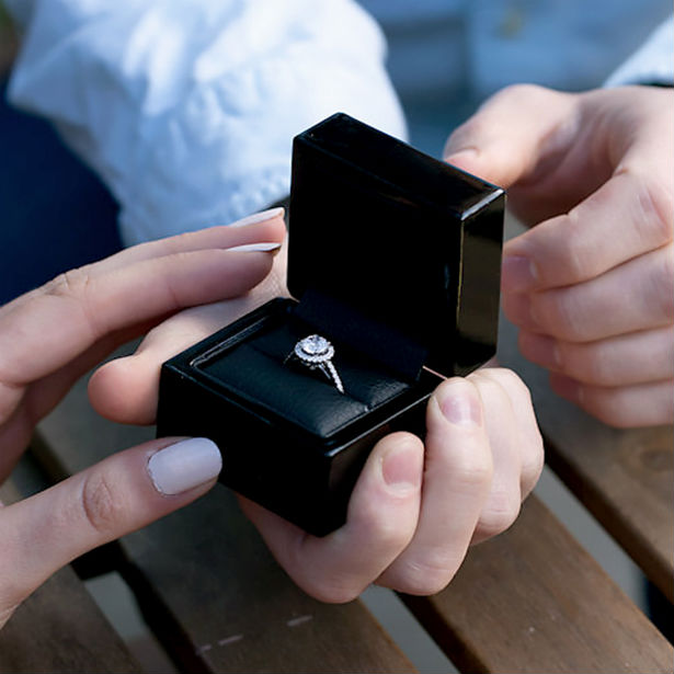 average diamond size in engagement ring man presenting woman with box