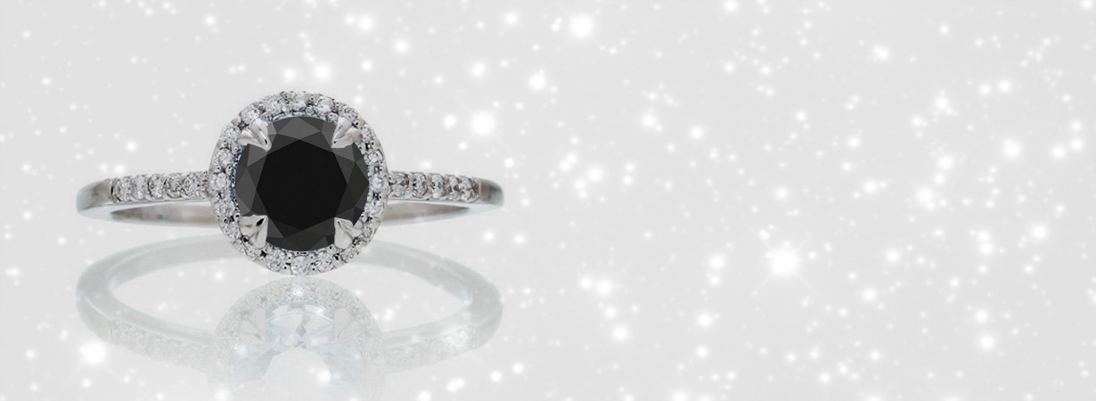 black diamond engagement ring on pink background