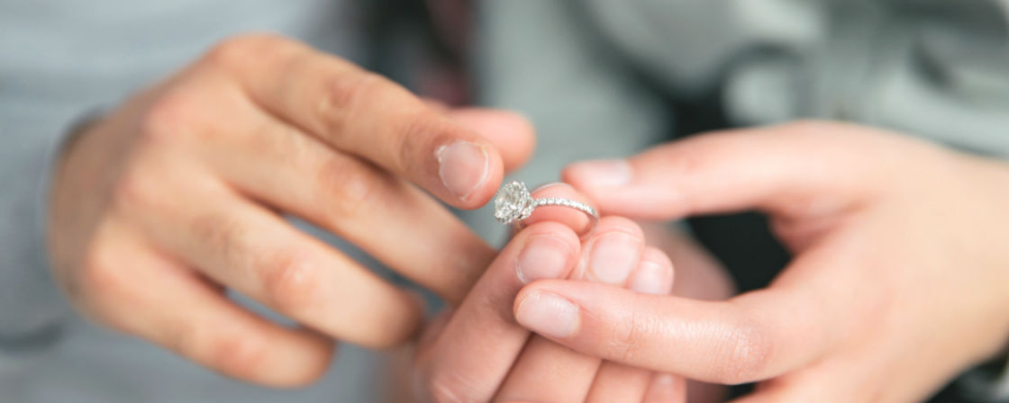 couple admiring engagement ring size