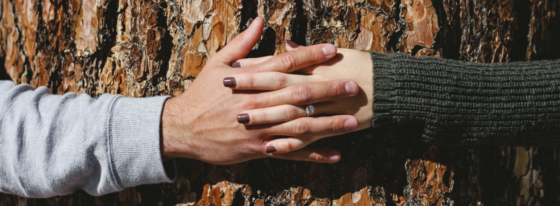 cushion cut vs princess cut couple holding hands around tree
