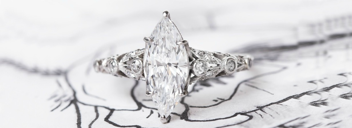 edwardian style engagement ring with marquise cut center stone