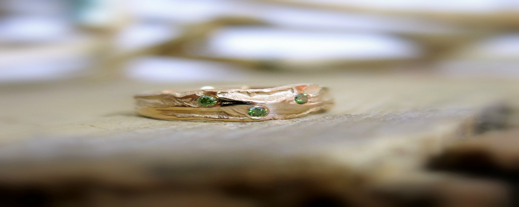 green diamonds in gold band
