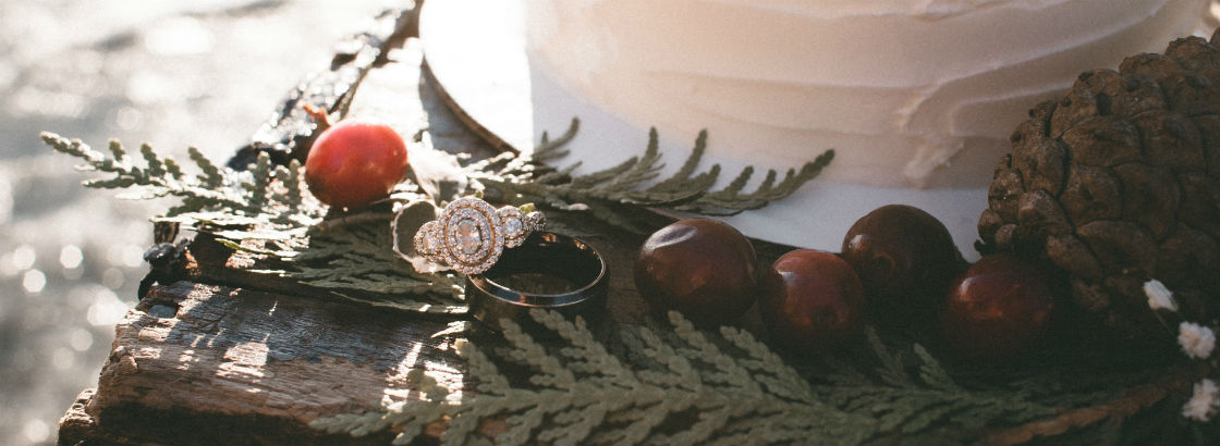 nature inspired engagement ring next to cake