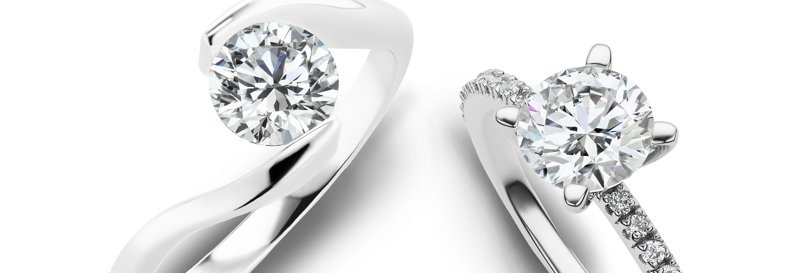 round cut engagement rings on a white background