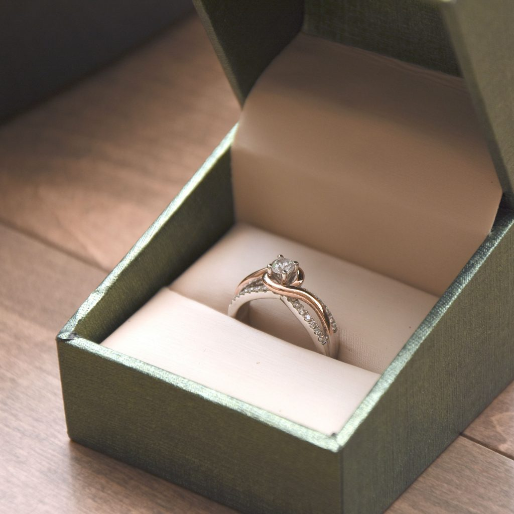 two tone engagement ring in a box
