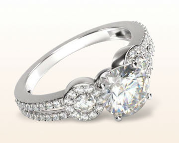 unusual engagement rings accent halo three stone