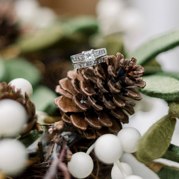 wide band engagement ring on pine cone