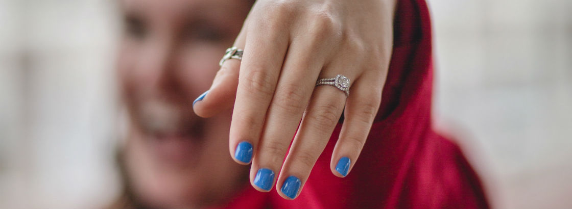 woman showing off split shank engagement ring