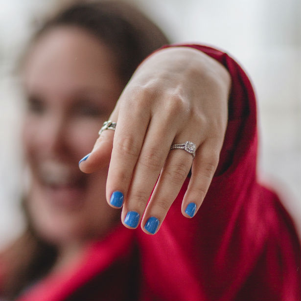 woman showing off split shank enaggement ring