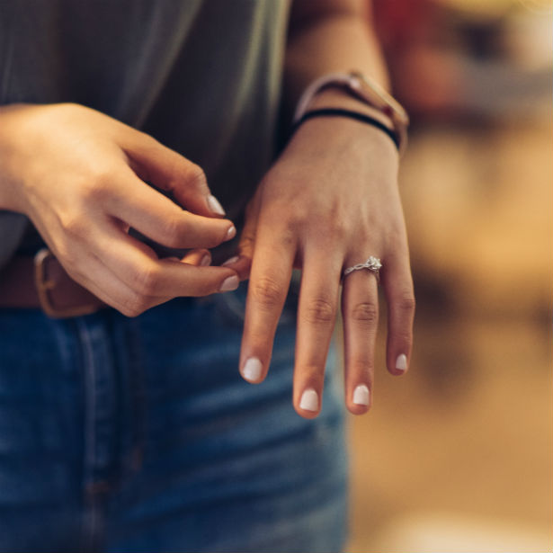 woman wearing infinity engagement ring
