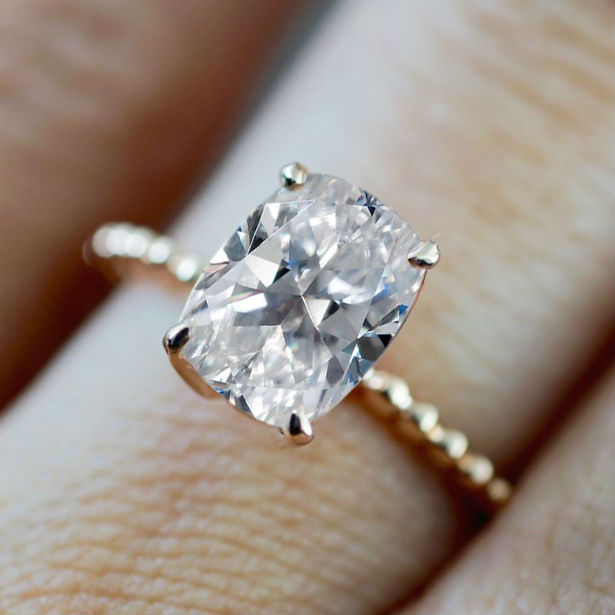 womans hand wearing ring with crushed ice diamond