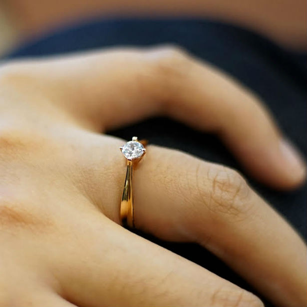 womans hand wearing cute engagement ring