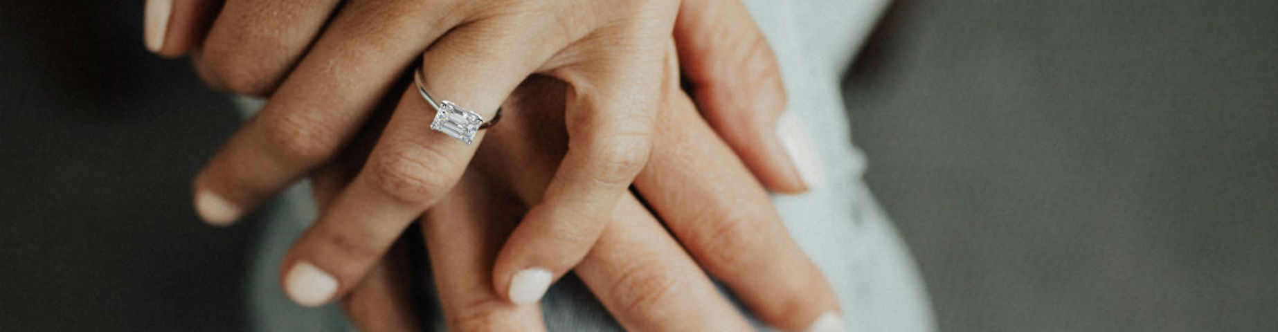womans hands wearing east west engagement ring