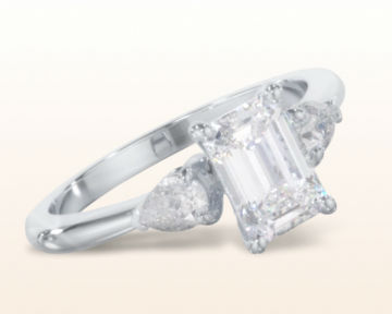 emerald cut three stone engagement rings pear