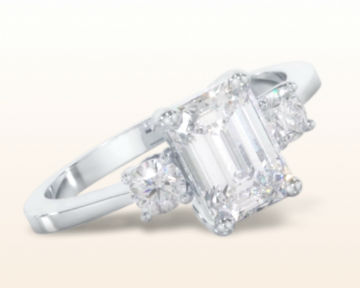 emerald cut three stone engagement rings petite