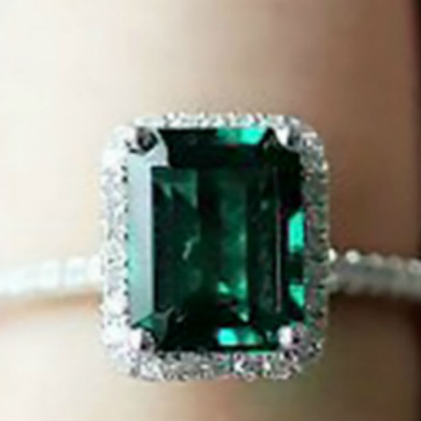 emerald engagement ring closeup on woman's finger
