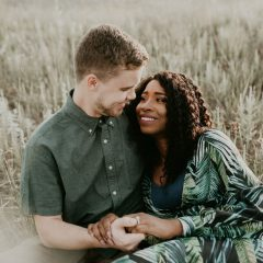 engaged couple in wheat field
