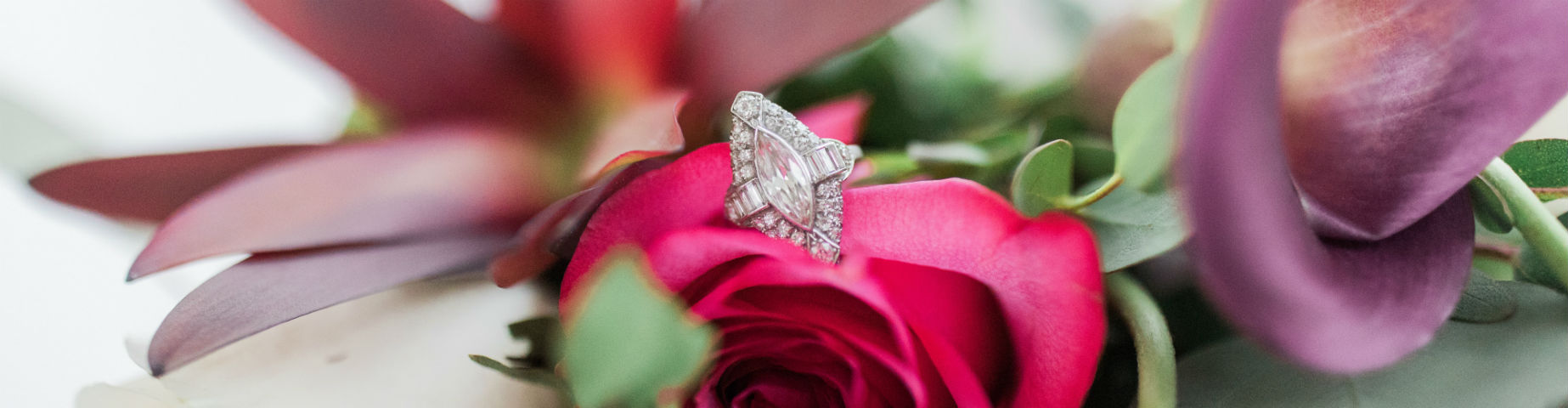 marquise engagement ring sitting on rose