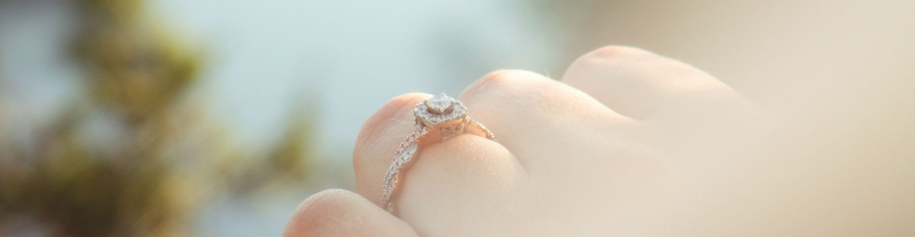profile of engagement ring on woman's hand