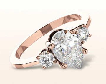 rose gold pear shaped engagement rings petite three stone