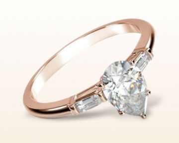 rose gold pear shaped engagement rings three stone baguette