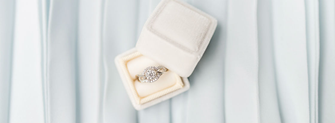 round halo engagement ring in blue box