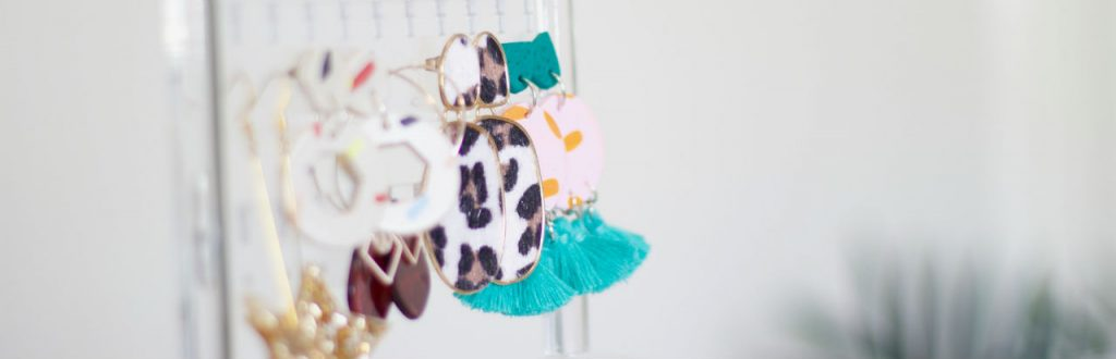 various backless earrings on stand