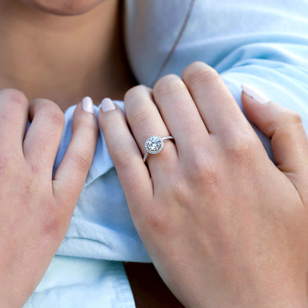 woman holding man's arm wearing a ring with a pave setting
