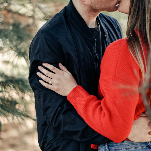 woman hugging fiance wearing non diamond engagement ring