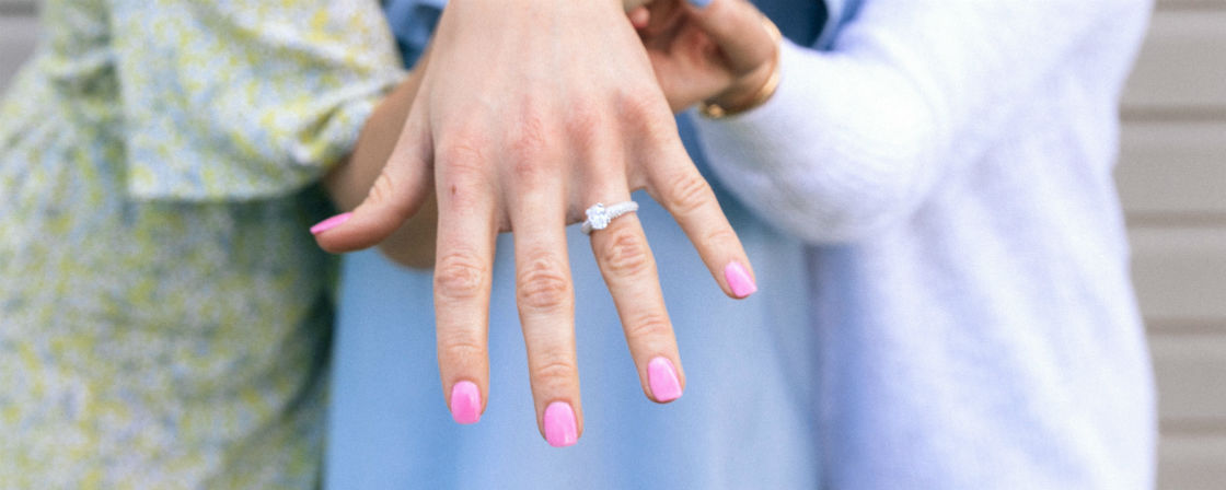 woman showing off her pretty engagement ring