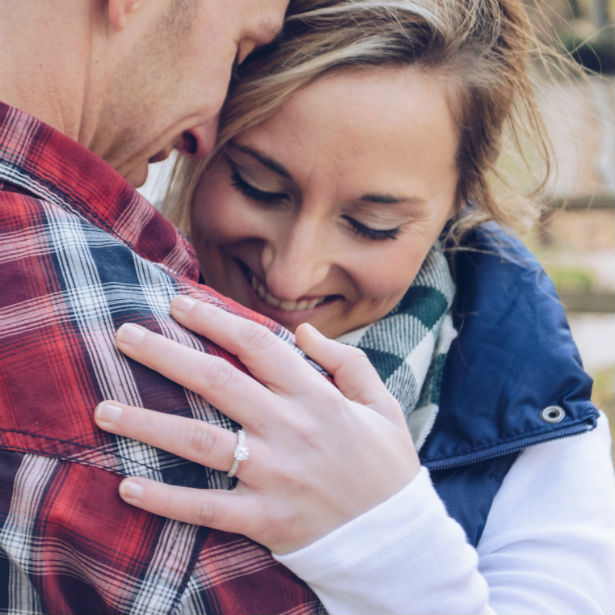 woman wearing pave engagement ring and hugging man