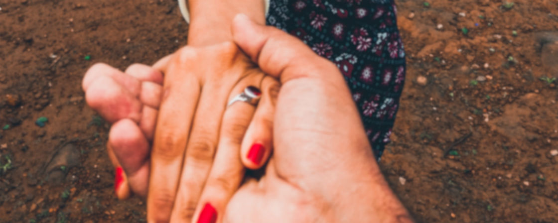 woman wearing ruby engagement ring grabbing fiance's hand