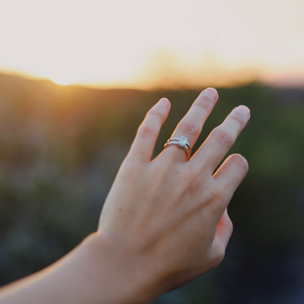 woman's hand wearing double band engagement ring