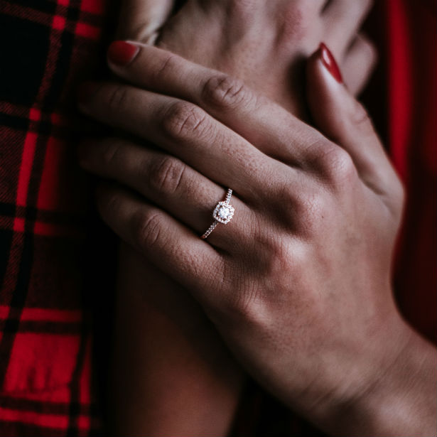 woman's hands wearing diamond engagement ring