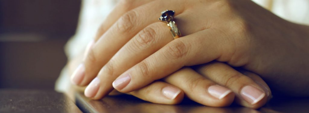 womans hands wearing ring with chocolate diamonds