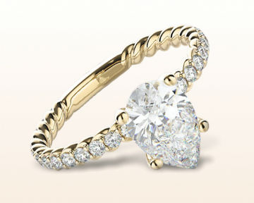 yellow gold pear shaped engagement rings coil accent