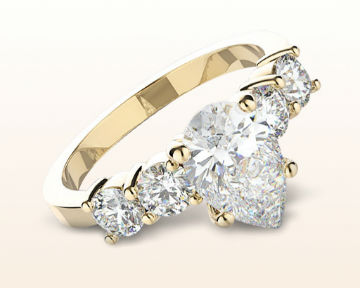 yellow gold pear shaped engagement rings five stone