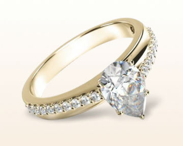 yellow gold pear shaped engagement rings rising accents