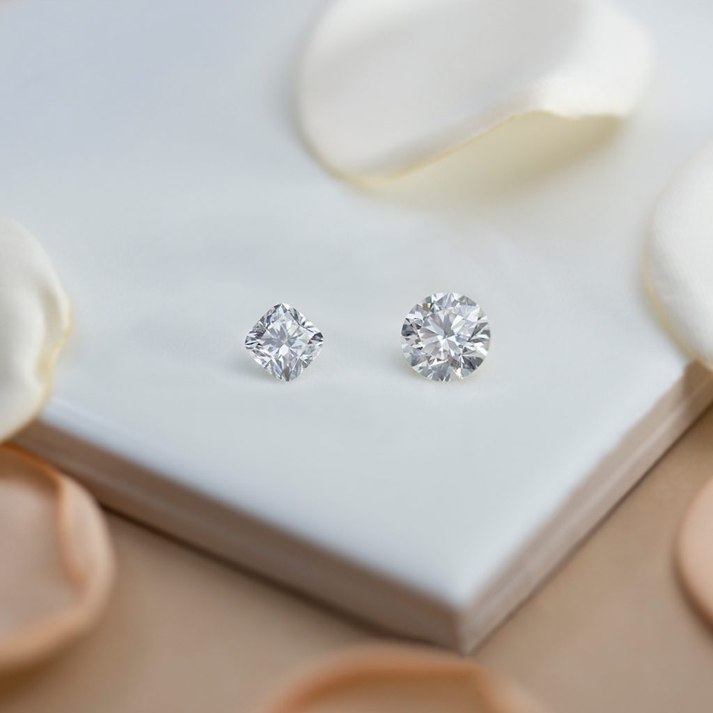 Two loose diamonds: Cushion cut and round cut
