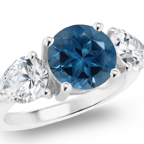 London Blue Topaz Three Stone Ring in white gold