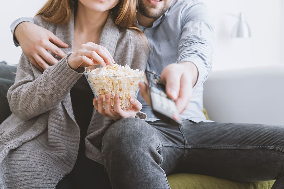 Couple watching movie together, marriage proposal