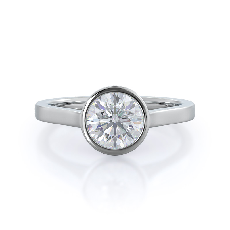 Bezel solitaire engagement ring, 14 kt white gold, round shape.