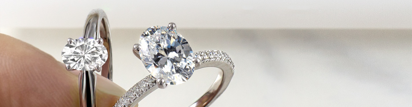 Four prong oval moissanite solitaire white gold ring & oval pave moissanite white gold ring