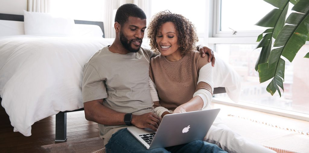 Couple buying an engagement ring online