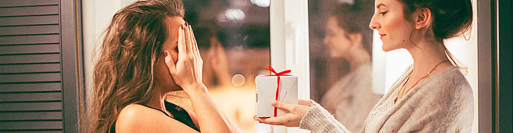 Bridesmaid proposal-woman giving present to another woman